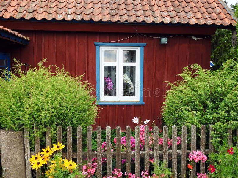 Old home window, flowers and fence, Lithuania royalty free stock image