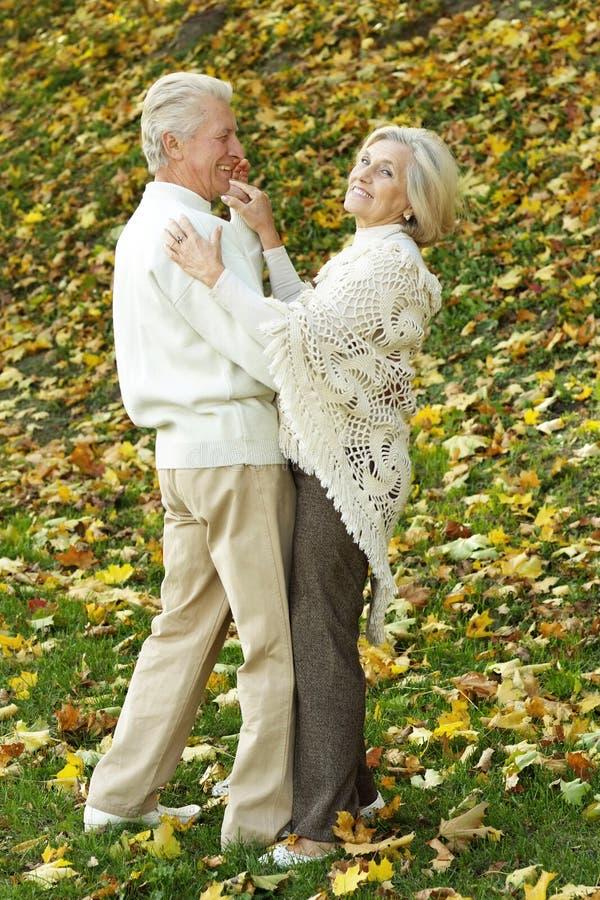 Nice older couple standing stock photos