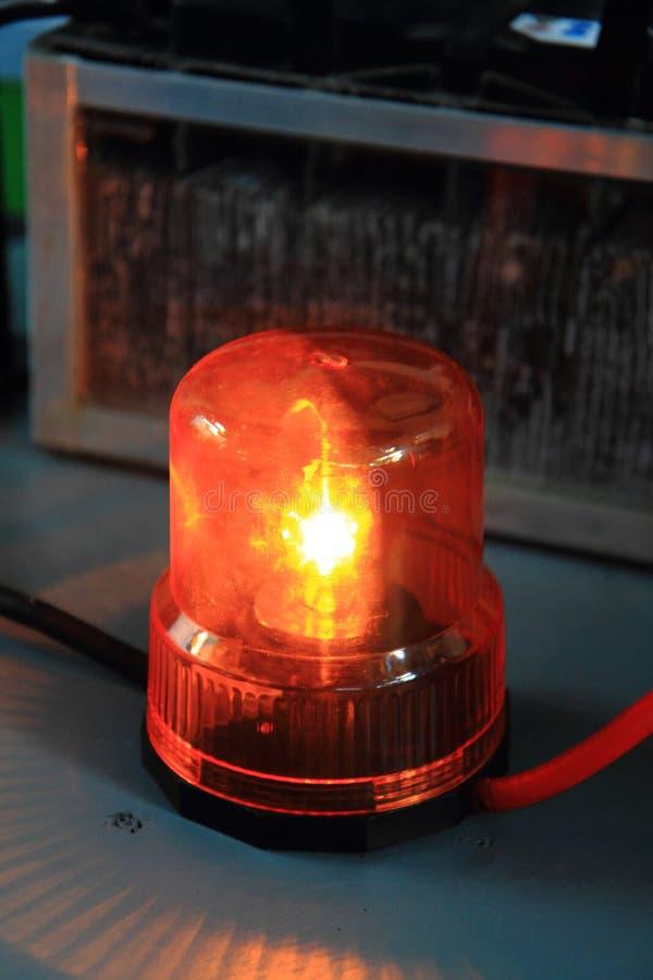 Nice orange siren. As traditional danger symbol stock photo