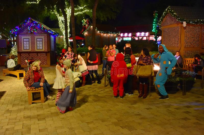 Nice people with sleepwear around the fire in Christmas Market areain International Drive area. stock photos