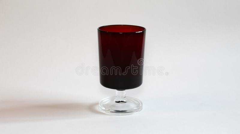 Red glass for liqueur stock photography