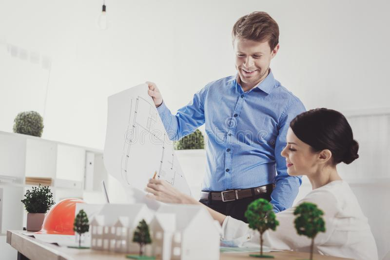 Nice positive colleagues looking at the drawing stock image