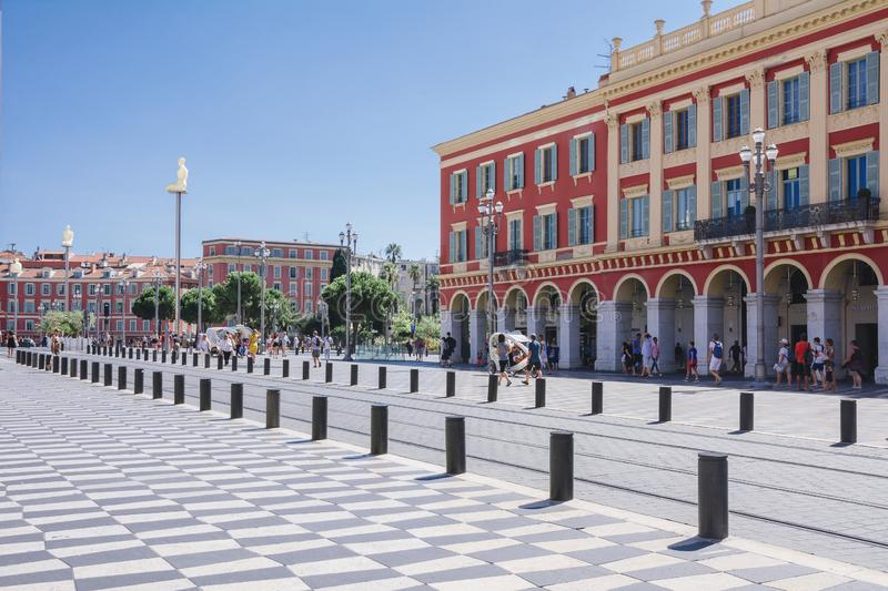 Nice, Provance, Alpes, Cote d`Azur, French,  August 15, 2018; A view of the place Massena square with tramway rails, red houses. stock photo