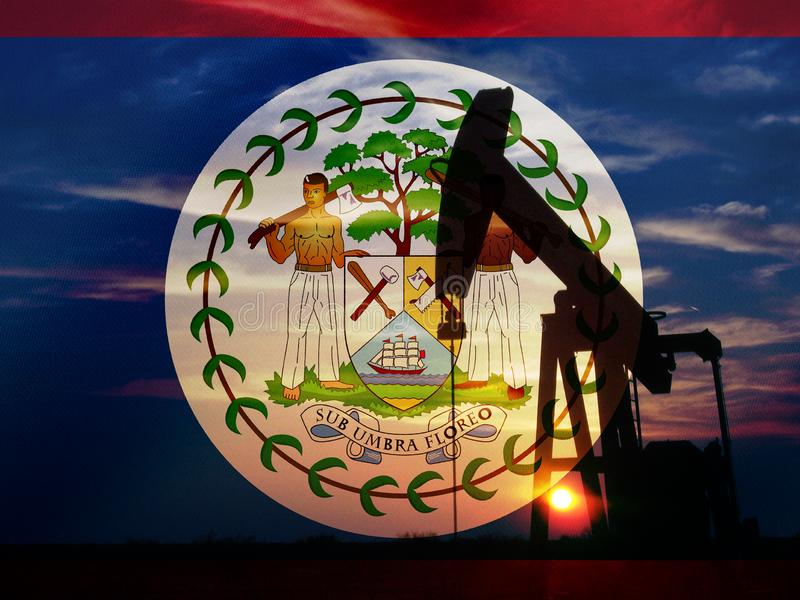 Nice pumpjack oil extraction and cloudy sky in sunset with Belize flag stock images