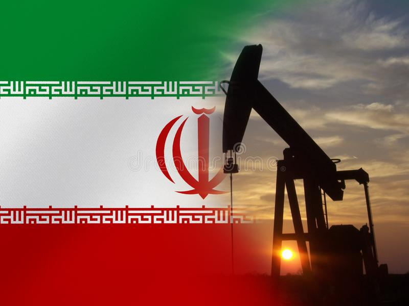 Nice pumpjack oil extraction and cloudy sky in sunset with the Iran flag.  stock image