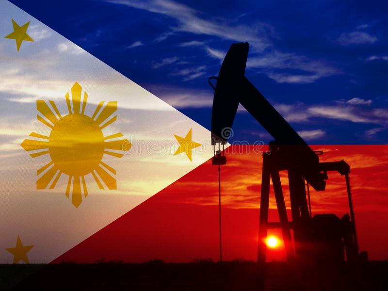Nice pumpjack oil extraction and cloudy sky in sunset with the Philippines flag.  stock photography