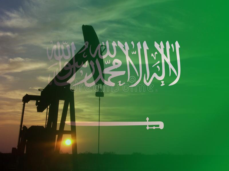 Nice pumpjack oil extraction and cloudy sky in sunset with the Saudi Arabia flag royalty free stock photo