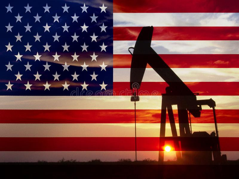 Nice pumpjack oil extraction and cloudy sky in sunset with the United States of America flag.  stock photography