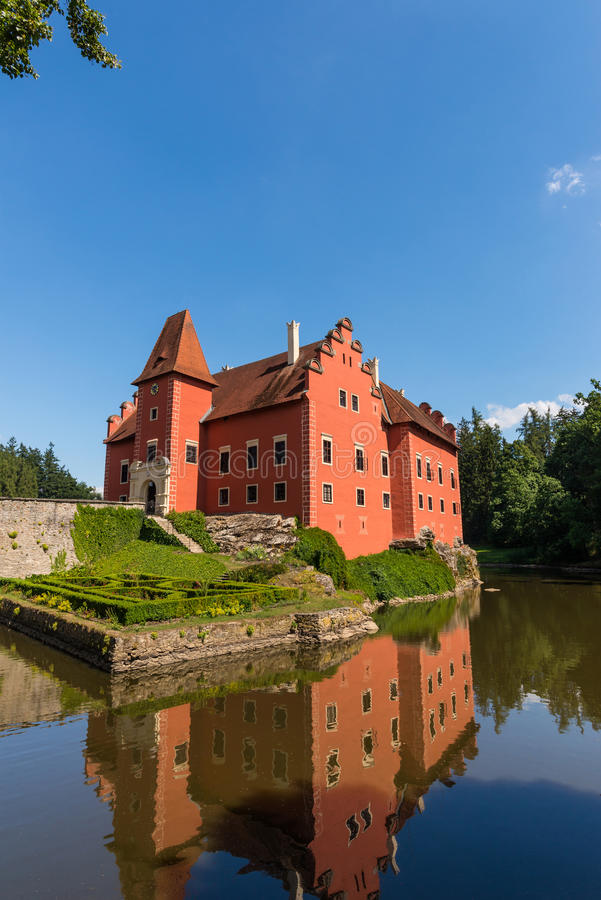 Nice romantic castle with red color in the middle of lake royalty free stock image