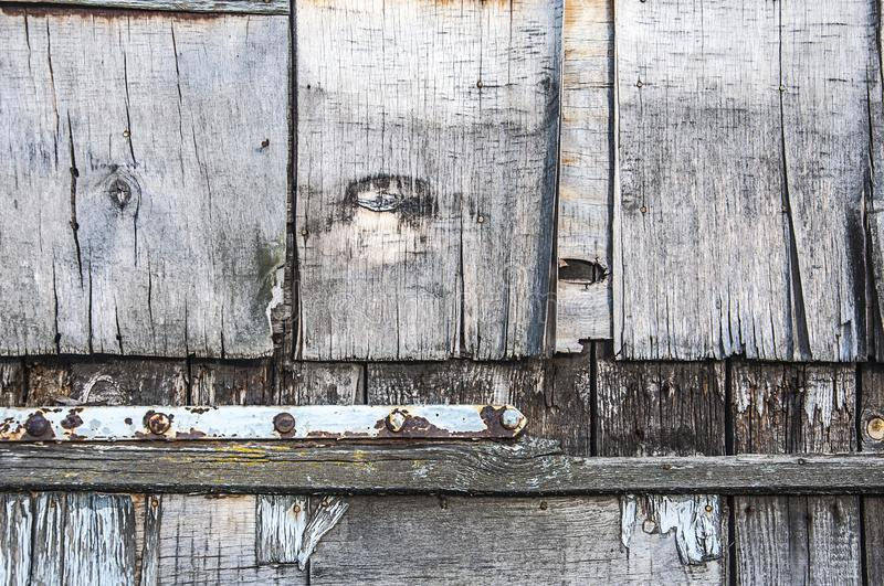 Nice rusty grungy background of wooden doors.  stock photography