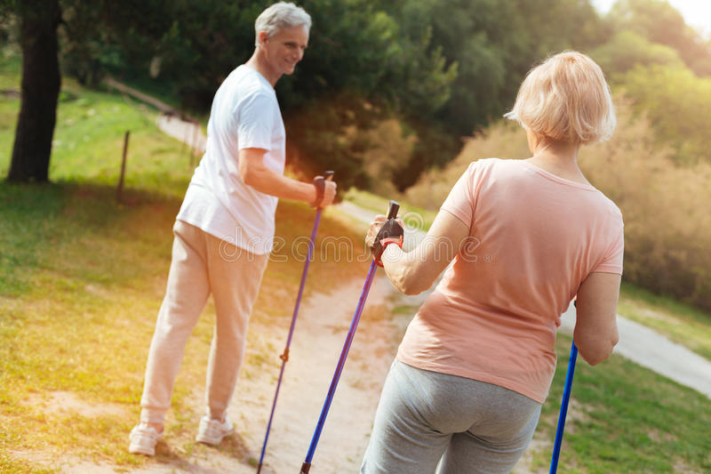 Nice senior couple walking on the footpath royalty free stock photography