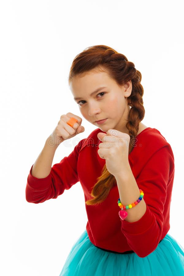Nice serious girl being ready to fight royalty free stock photos