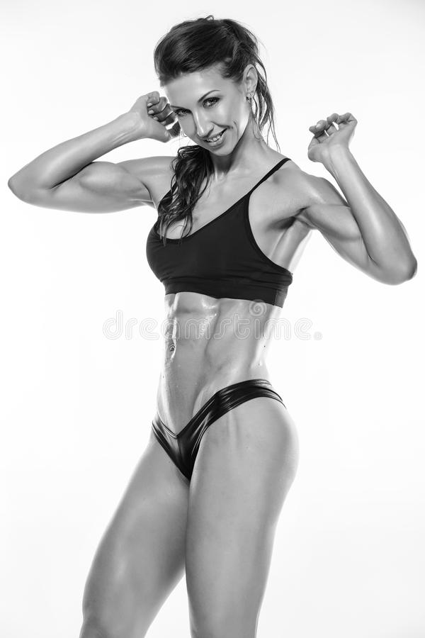 Nice fitness woman showing abdominal muscles stock photos