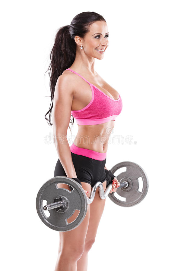 Nice woman doing workout with big dumbbell, retouched royalty free stock photos