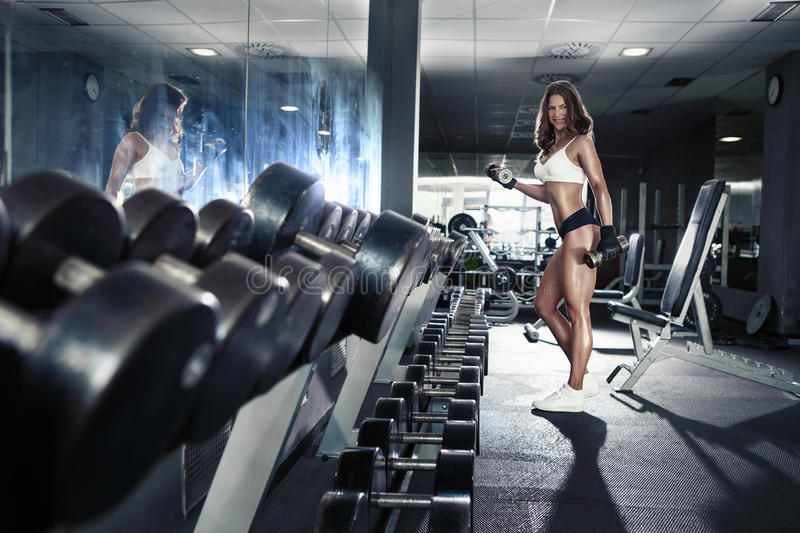 Nice woman doing workout with dumbbells stock image