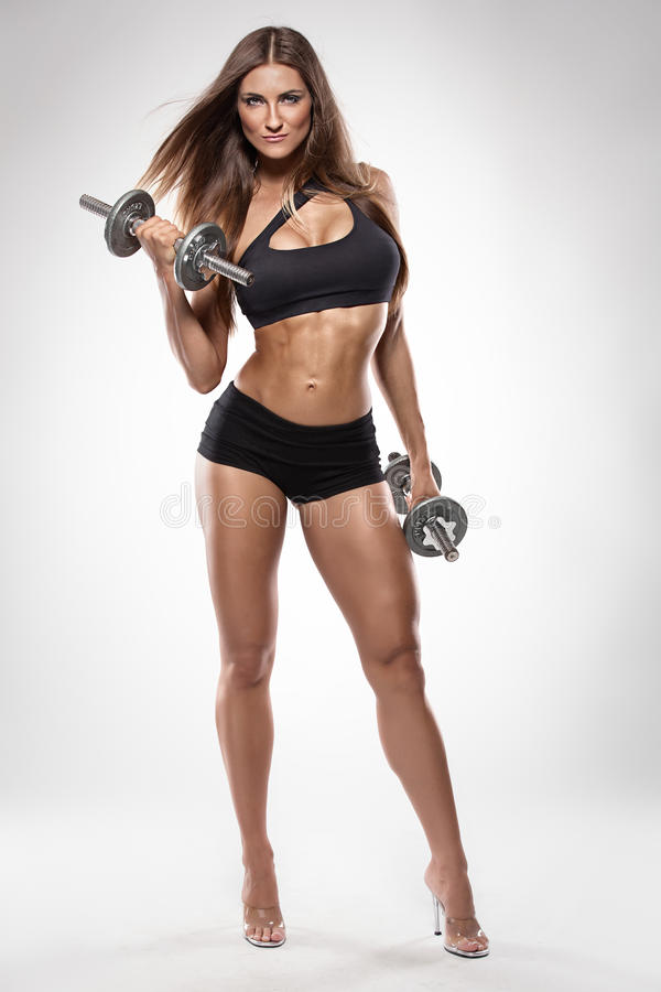 Nice woman doing workout with dumbbells royalty free stock images