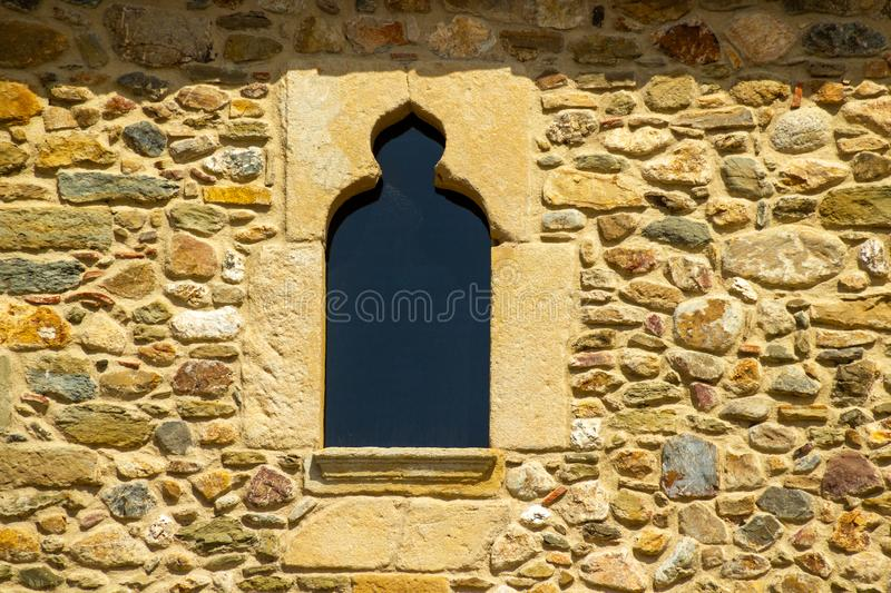 Nice shaped window in Monells royalty free stock photography