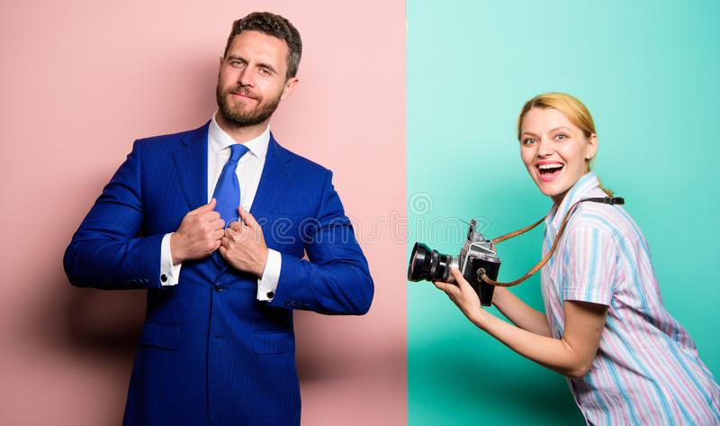Nice shot. Fame and success. Businessman enjoy star moment. Photographer taking photo successful businessman. Paparazzi royalty free stock images