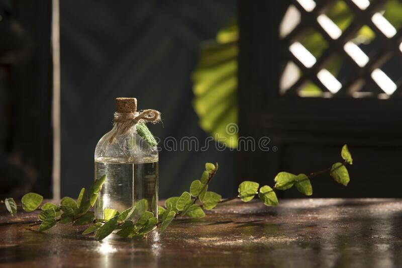 nice small bottle with massage oil on color back royalty free stock image