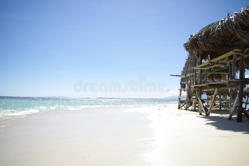 Nice and small lodge with beautiful white sand in the Dominican Republic royalty free stock photo