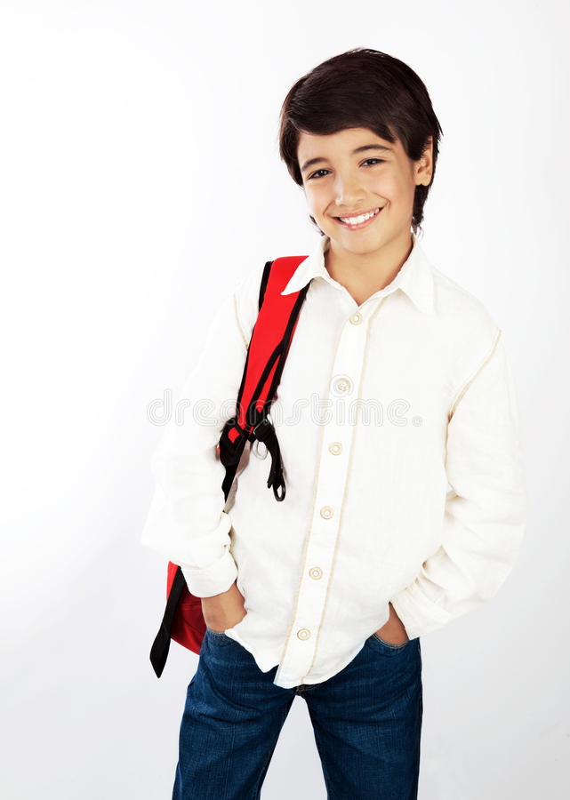 Nice smiling school boy. Isolated on white background, pretty teen male with red backpack, portrait of beautiful brunet pupil, smart child in studio, knowledge stock photo