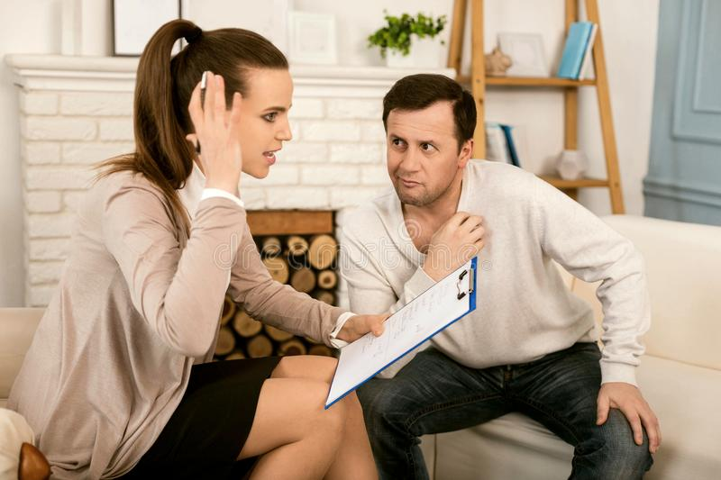 Nice stressed out woman talking to her patient stock photography