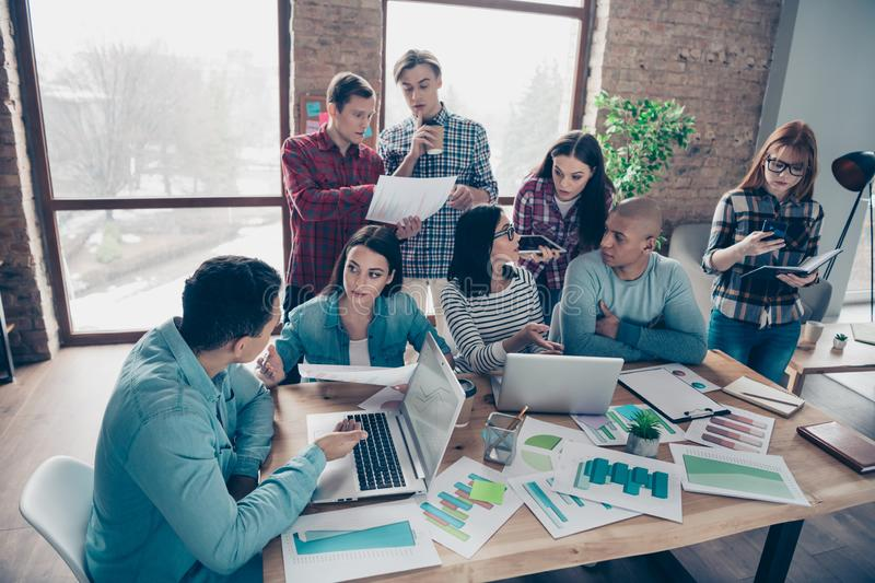 Nice stylish busy attractive serious sharks specialists experts executive managers in casual preparing corporate. Research at industrial loft interior workplace stock photos