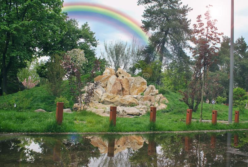 Nice summer rainbow over the montains. rainbow, rocky mountain. the mountains are reflected in the water. Great yellow stones stock photos
