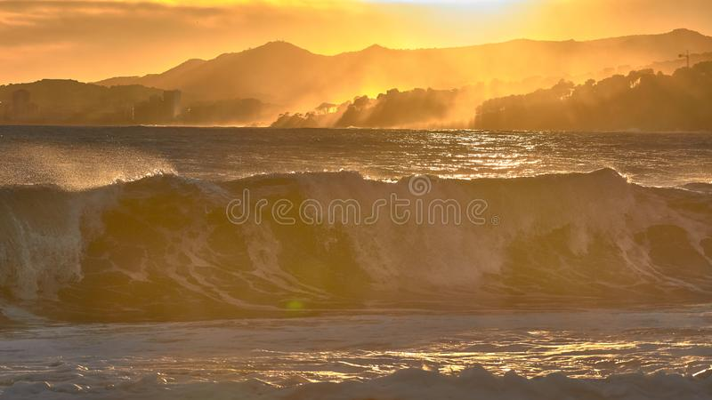 Nice sunlight in a windy sunset over the waves in Costa Brava of Spain royalty free stock photography