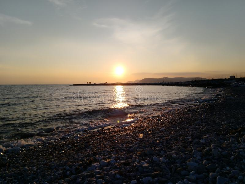 The nice sunset at the beach. royalty free stock photos