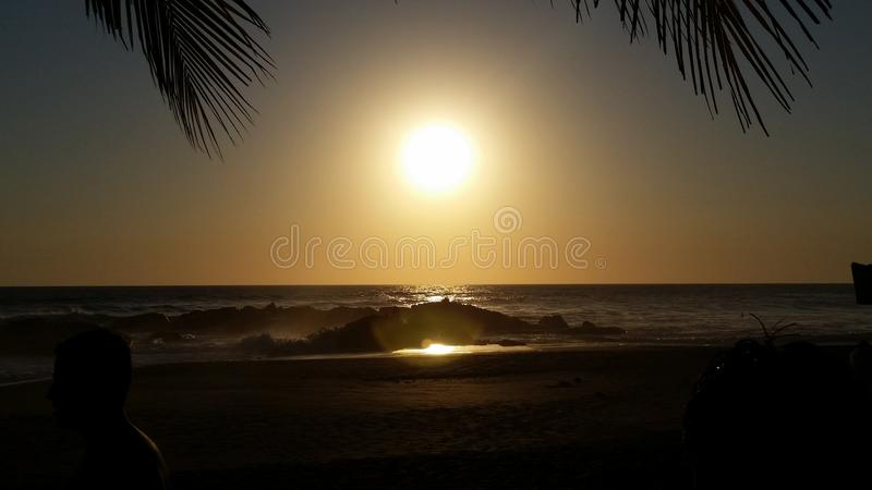 Nice sunset. A close capture of the sun as it goes down at the poneloya beach Nicaragua royalty free stock image