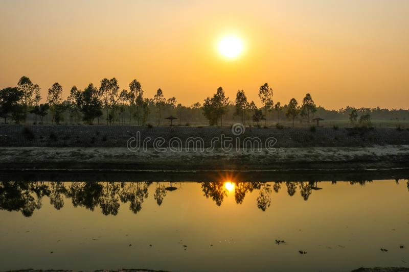 Nice Sunset moment at evening on small river stock photo