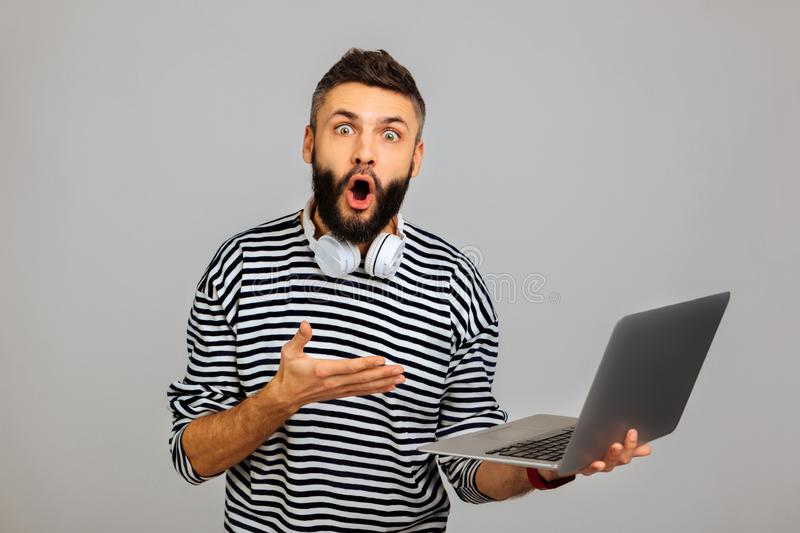Nice surprised bearded man looking at you stock image