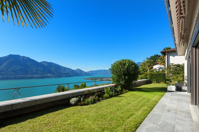 Nice terrace with green lawn stock photos