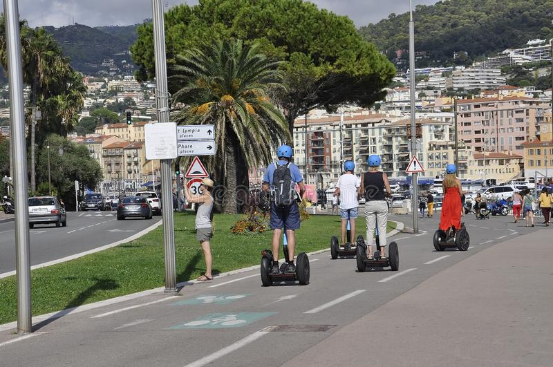 Nice, 5th september: Tourists on Segway tour on Promenade des Anglais boulevard from Nice of French Riviera. Tourists on Segway tour on Promenade des Anglais stock image