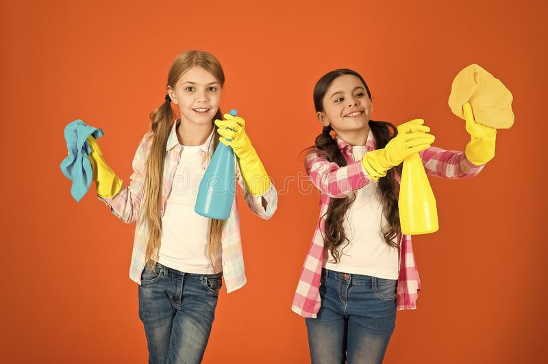 Nice and tidy. Girls with mist spray and rag ready for cleaning. Household duties. Little helper. Girls cute kids love. Cleaning around. Keep it clean. We are royalty free stock photos
