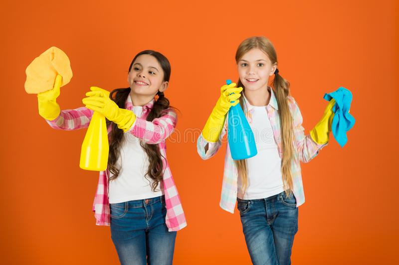 Nice and tidy. Girls with mist spray and rag ready for cleaning. Household duties. Little helper. Girls cute kids love. Cleaning around. Keep it clean. We are stock photos