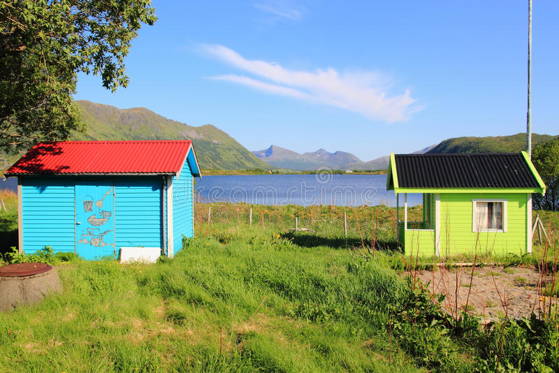 Is nice to be a kid in Lofoten. Houses of a Kindergarten painted whit flourecet colours royalty free stock image