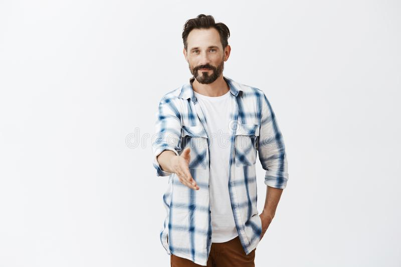 Nice to meet you, I am bachelor. Good-looking confident and friendly caucasian mature male with stylish haircut and stock photography