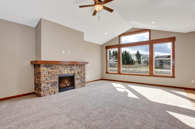 Nice unfurnished living room with carpet. Nice carpet unfurnished living room with fireplace stock photos