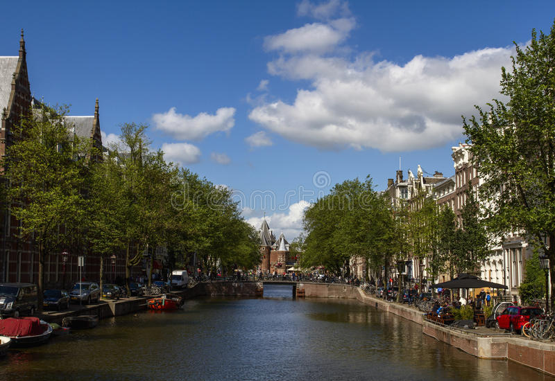 Nice view of the channel in the center of the city. Bridge and typical Dutch houses in the summer day. stock image