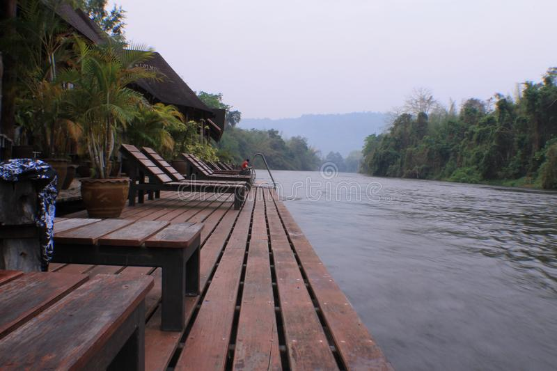 Nice vintage pool villa view in morning. Thailand nice vintage pool villa and flooding hotel at river stock photo