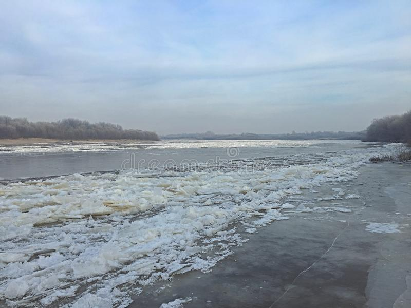 Winter begins and the river is covered with ice. Nice winter begins and the river is covered with ice stock images