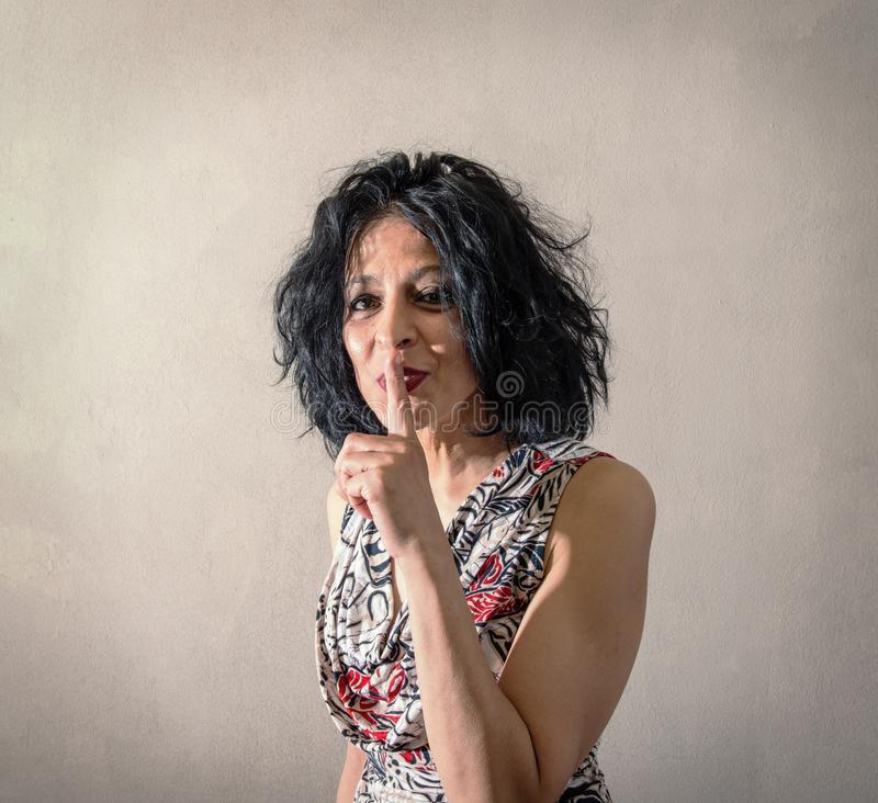 Nice woman doing the gesture of silencing royalty free stock image