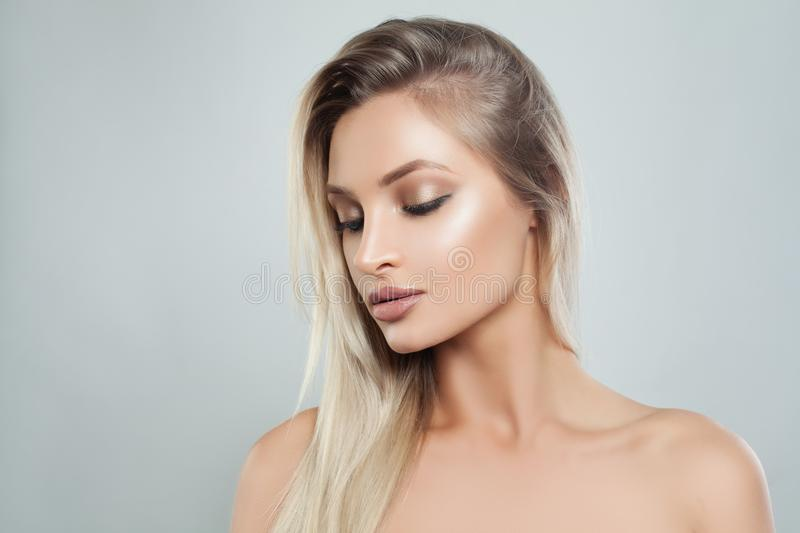 Nice Woman with Fresh Skin and Healthy Blonde Hair. Facial treatment. Cosmetology, beauty, haircare and spa stock image