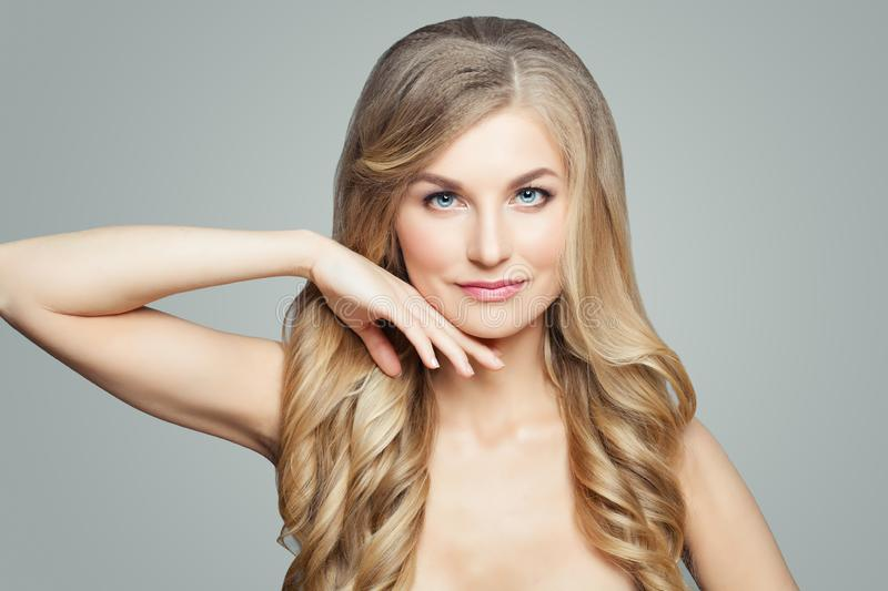 Nice woman with long blonde hair and clear skin. Facial treatment, spa, skincare and cosmetology. Concept stock image