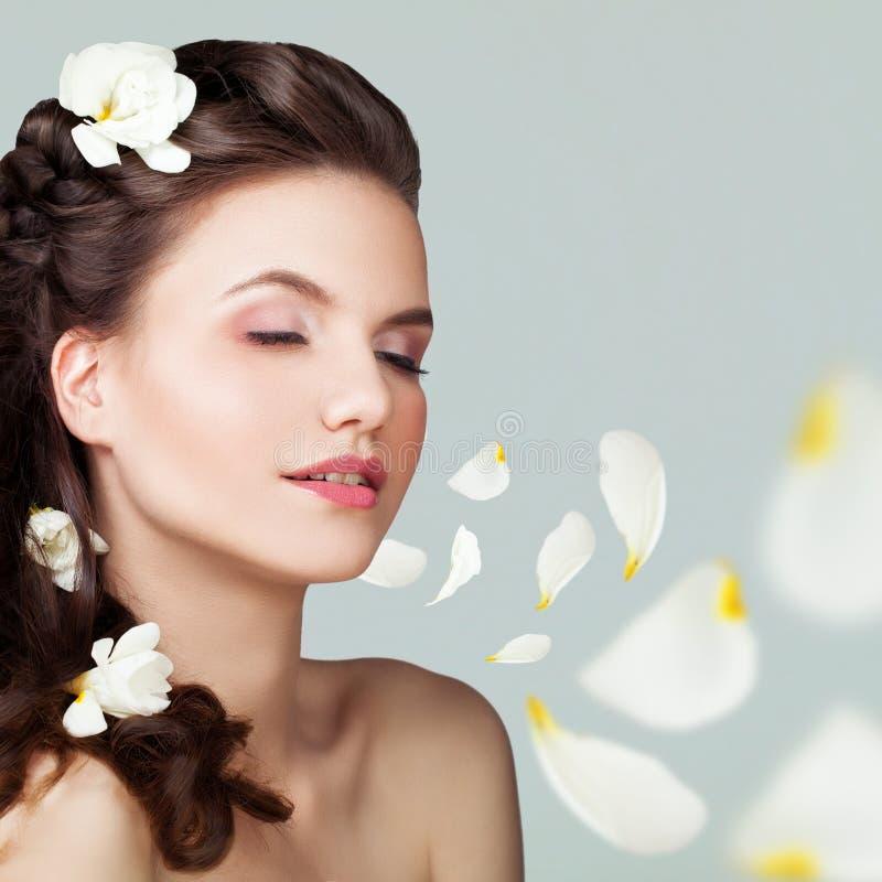 Nice Woman with Long Brown Hair, Makeup, Flowers. And Rose Petals stock photos