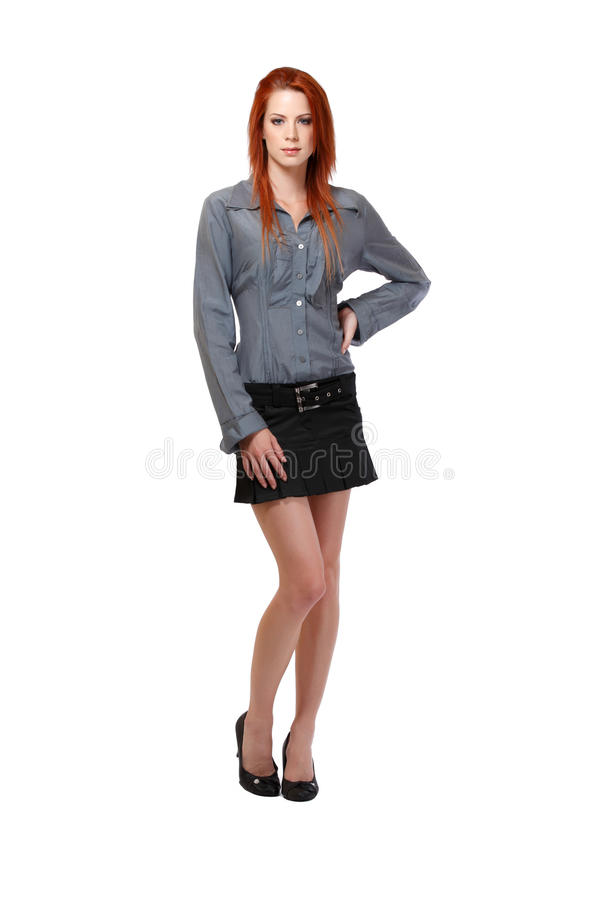 Nice woman with red hair in studio