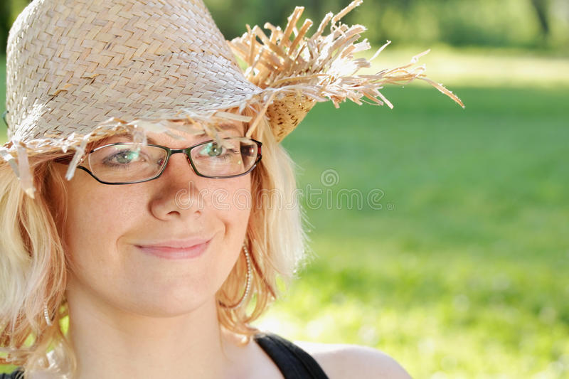 Nice woman with straw hat stock photo