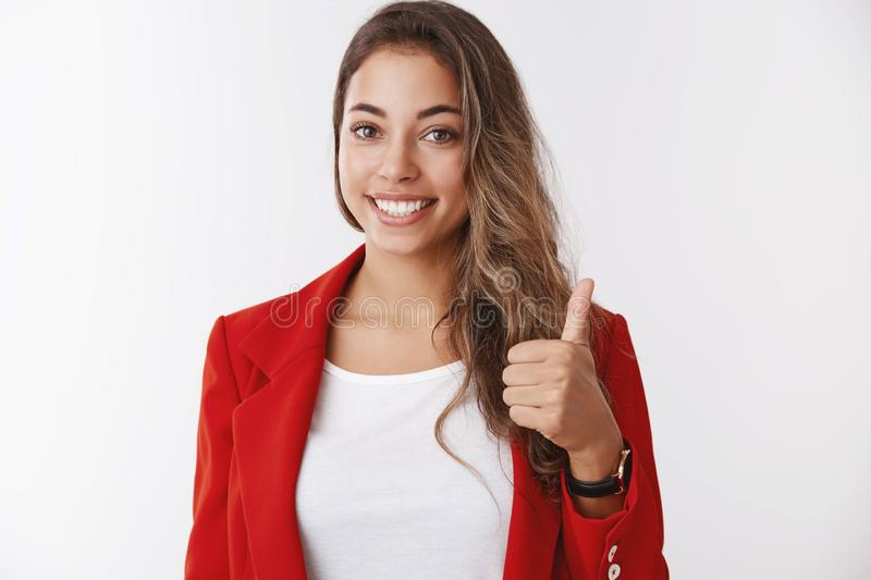Nice work, proud you. Portrait supportive female team member showing thumb up gesture smiling approvingly, liking. Agreeing, impressed great coworker effort royalty free stock images